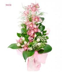 Букет из ветки орхидеи, 7 тюльпанов и зелени «Крылья феи»